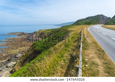 road along the beautiful coast of normandy, france. - stock photo