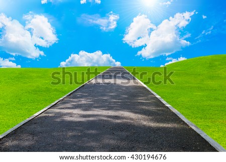 road and green grass with sunlight in golf