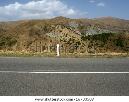 road and hill - stock photo