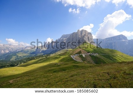 Road and restaurant high in the Alps. - stock photo