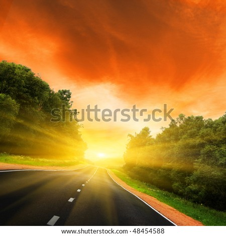 Road and sun. - stock photo