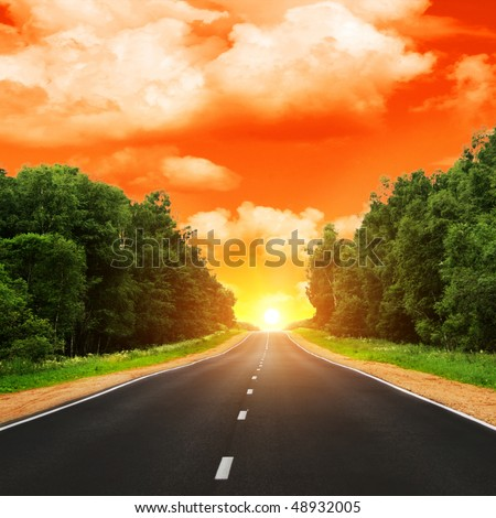 Road and sunset. - stock photo
