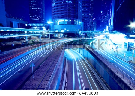 Road and traffic in downtown area of Hong Kong - stock photo