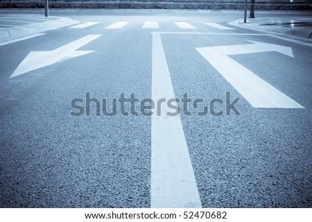 road arrow sigh at  night - stock photo
