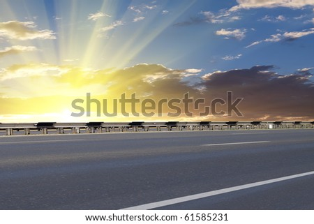 Road; asphalted; sunrise - stock photo