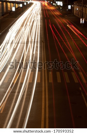 Road at night with traffic trails and blurred lights