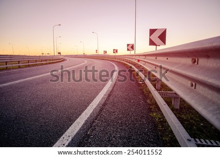 Road at the sunrise - stock photo