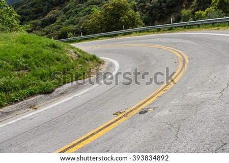 Road banks in a sharp bend in southern California mountains near Los Angeles. - stock photo