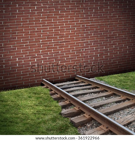 Road block or roadblock concept as a closed brick wall barricade blocking a train track as a business or life  closed metaphor for restriction or embargo symbol. - stock photo
