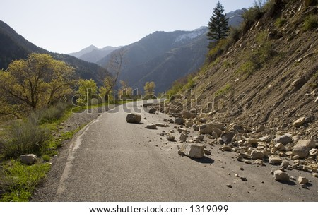 Road blocked because some rocks are in the way. Good for conceptual use for such things as obstacles. - stock photo