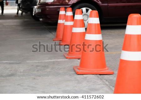 Road bollard Traffic cones in the car park - stock photo