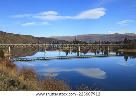 Road bridge over Lake Dunstan, Cromwell town, near Queenstown, Central Otago region, South Island, New Zealand. - stock photo