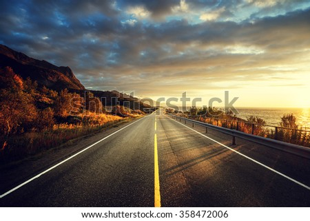 road by the sea in sunrise time,  Lofoten island, Norway - stock photo
