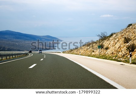 Road by the sea. Summer vacation road trip concept. - stock photo