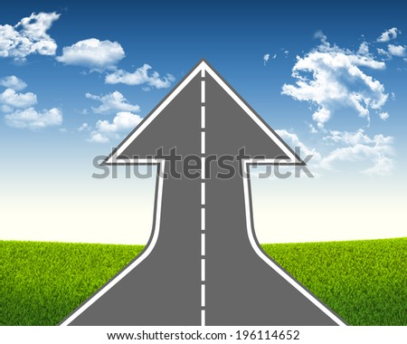Road climbs up. Field of grass and sky as background