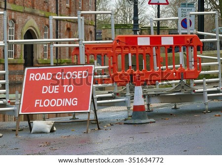 Road close sign in front of pedestrian walkway crossing flooded water - stock photo