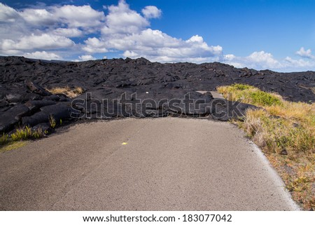 Road closed by lava in hawaii - stock photo