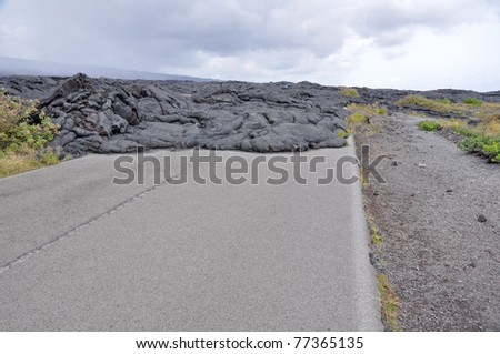 Road closed by lava in Hawaii Volcanoes National Park - stock photo