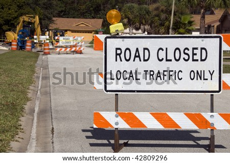 Road Closed signage due to construction ahead - stock photo