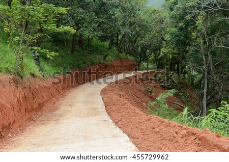 road construction in the forest with red earth - stock photo