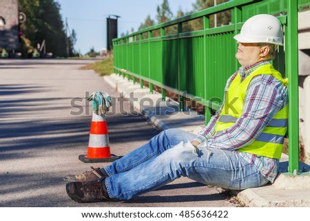 Road construction worker sleep on the bridge