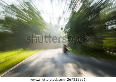 Road countryside in motion blur - stock photo
