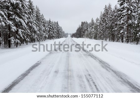 Road covered with snow - stock photo