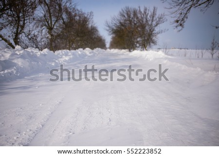 Road covered with snow bokeh