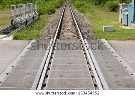 road crossing the railway and the barrier - stock photo
