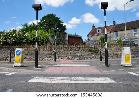 Road Crossing with Pedestrian Island in a Typical English Town - Road Safety Theme - stock photo