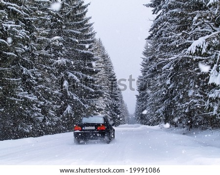 Road During Snowfall - stock photo