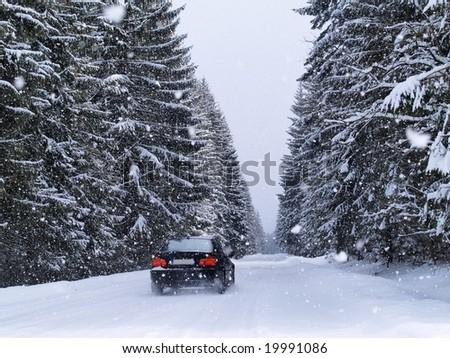 Road During Snowfall - stock photo