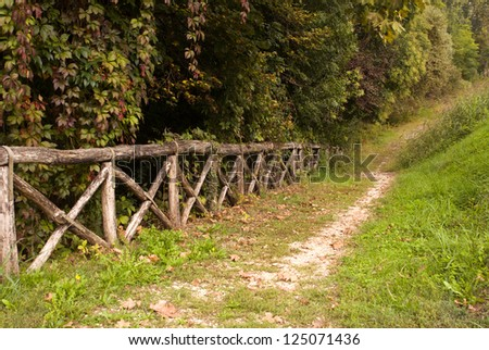 Road. Empty path along the old wooden fence - stock photo
