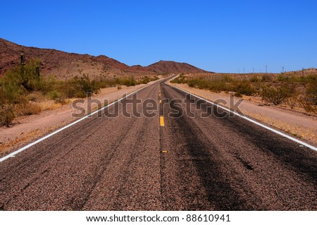 Road going off into the desert mountains
