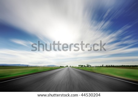Road going straight ahead with motion blur