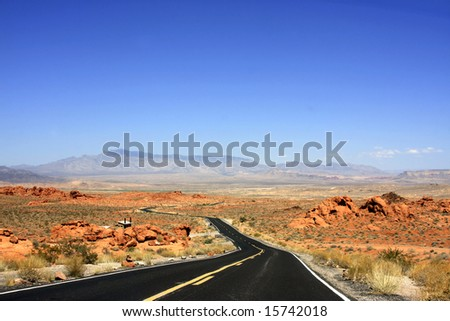 Road going through the Valley of Fire State Park of Nevada. - stock photo