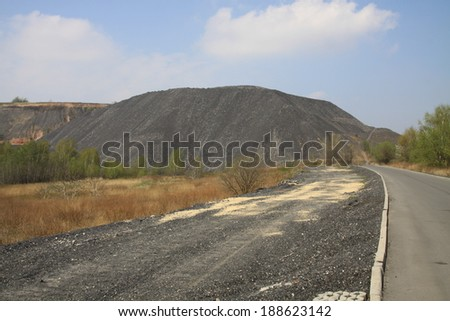 Road going to the heap of mine - stock photo