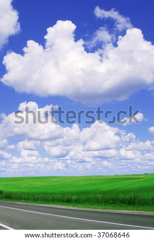 Road,green field and blue sky.