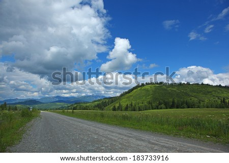 road in altai's mountains in summer - stock photo