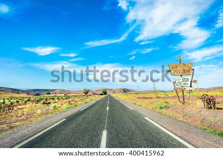 "Road in desern. With sign ""Last stop 200 miles"" - stock photo"