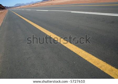 Road in desert - stock photo