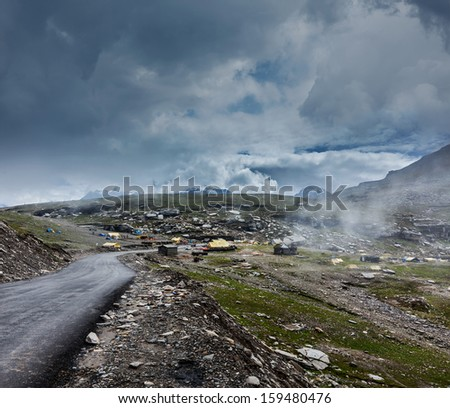 Road in Himalayas on top of  Rohtang La pass, Himachal Pradesh, India