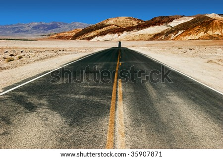 Road in lifeless landscape of the Valley of Death. California. USA - stock photo