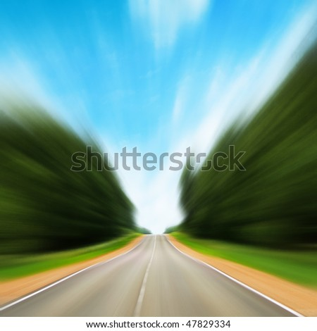 Road in motion blur. - stock photo