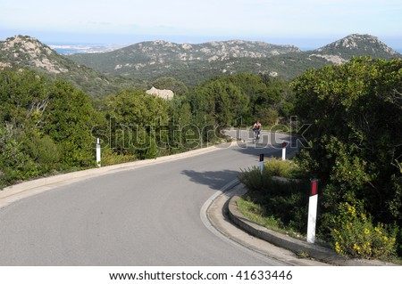 Road in Sardinia,Italy you can see a ciclist