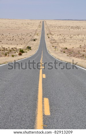 Road in the desert of New Mexico - stock photo
