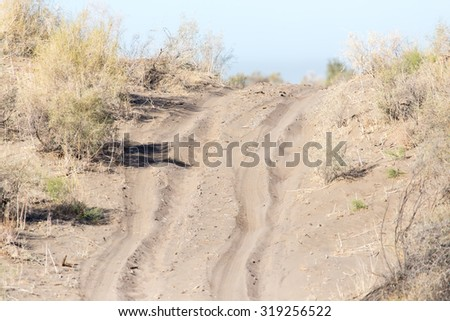 road in the desert steppe - stock photo