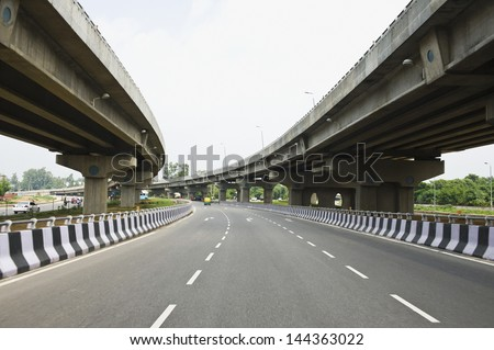 Road in the middle of overpasses, National Highway 8, New Delhi, India - stock photo