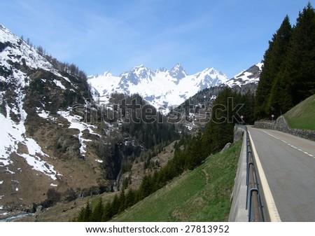 Road in the Swiss Alps in spring, Switzerland - stock photo