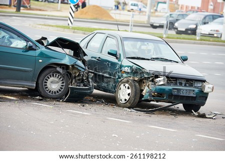road incident car crash on a street, damaged automobiles after collision in city - stock photo